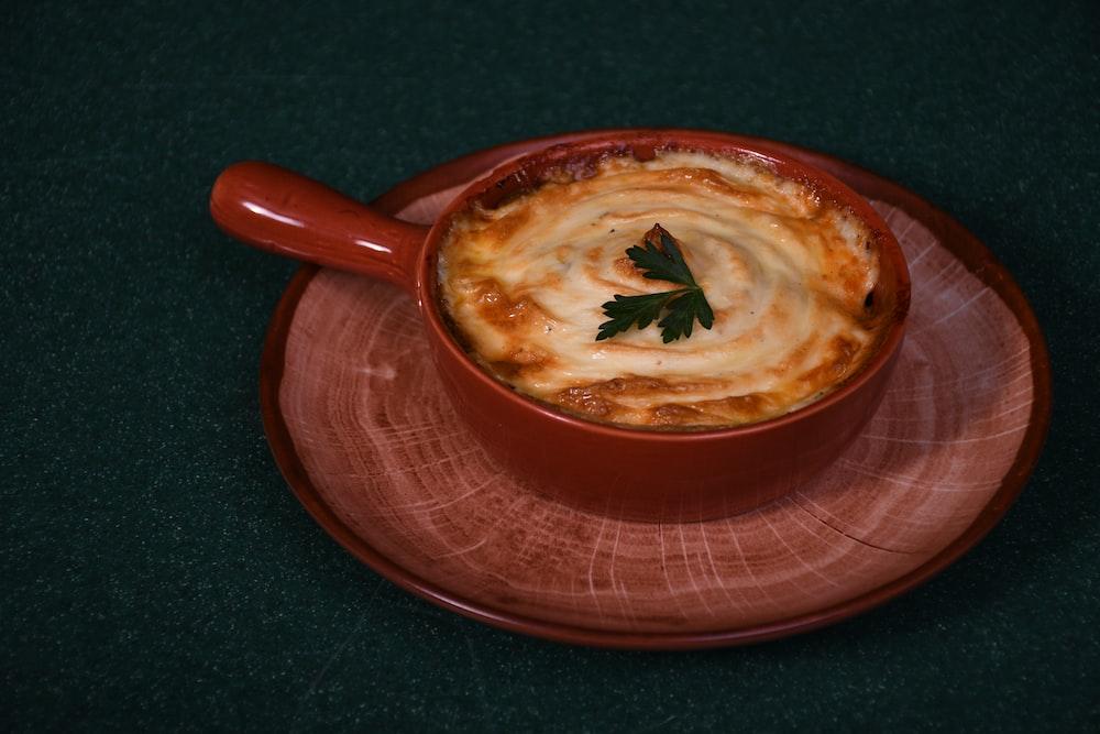 brown soup in red ceramic bowl