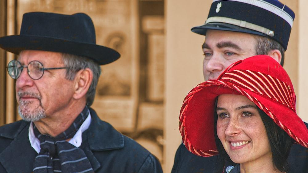 man in black hat and black coat