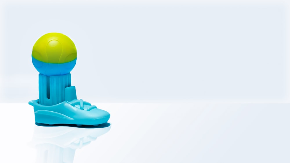 green frog on blue plastic toy