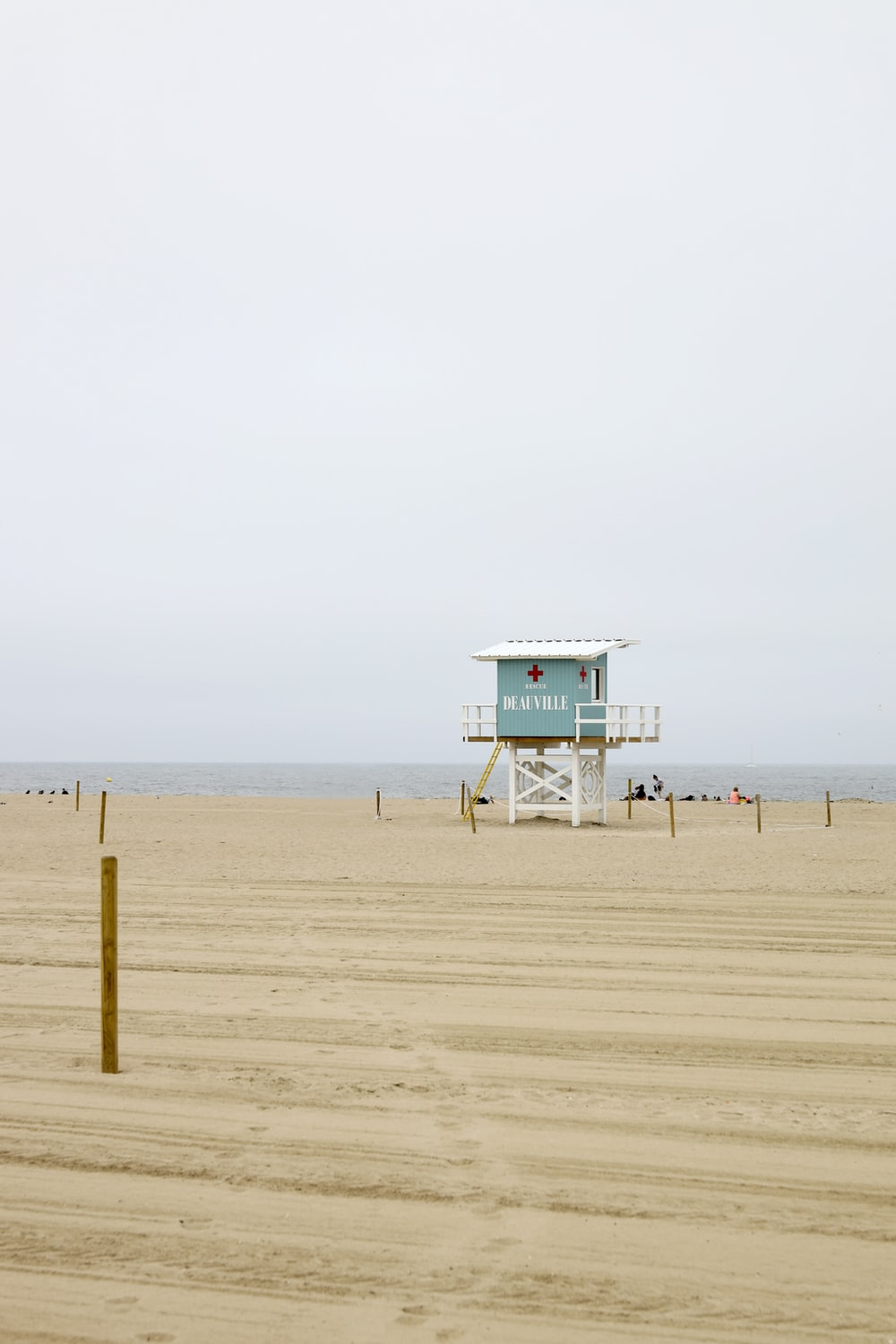 blue and white lifeguard tower on beach
