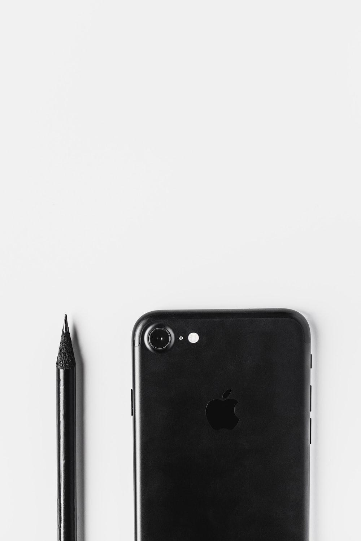 black iphone 7 plus beside black pen