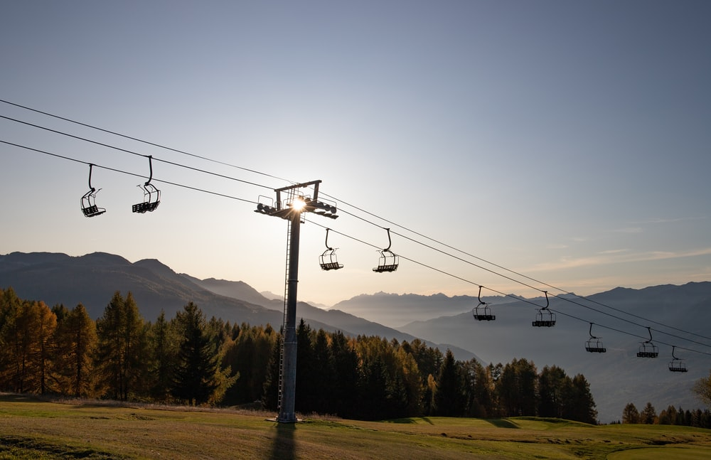 cable cars over the mountains during daytime