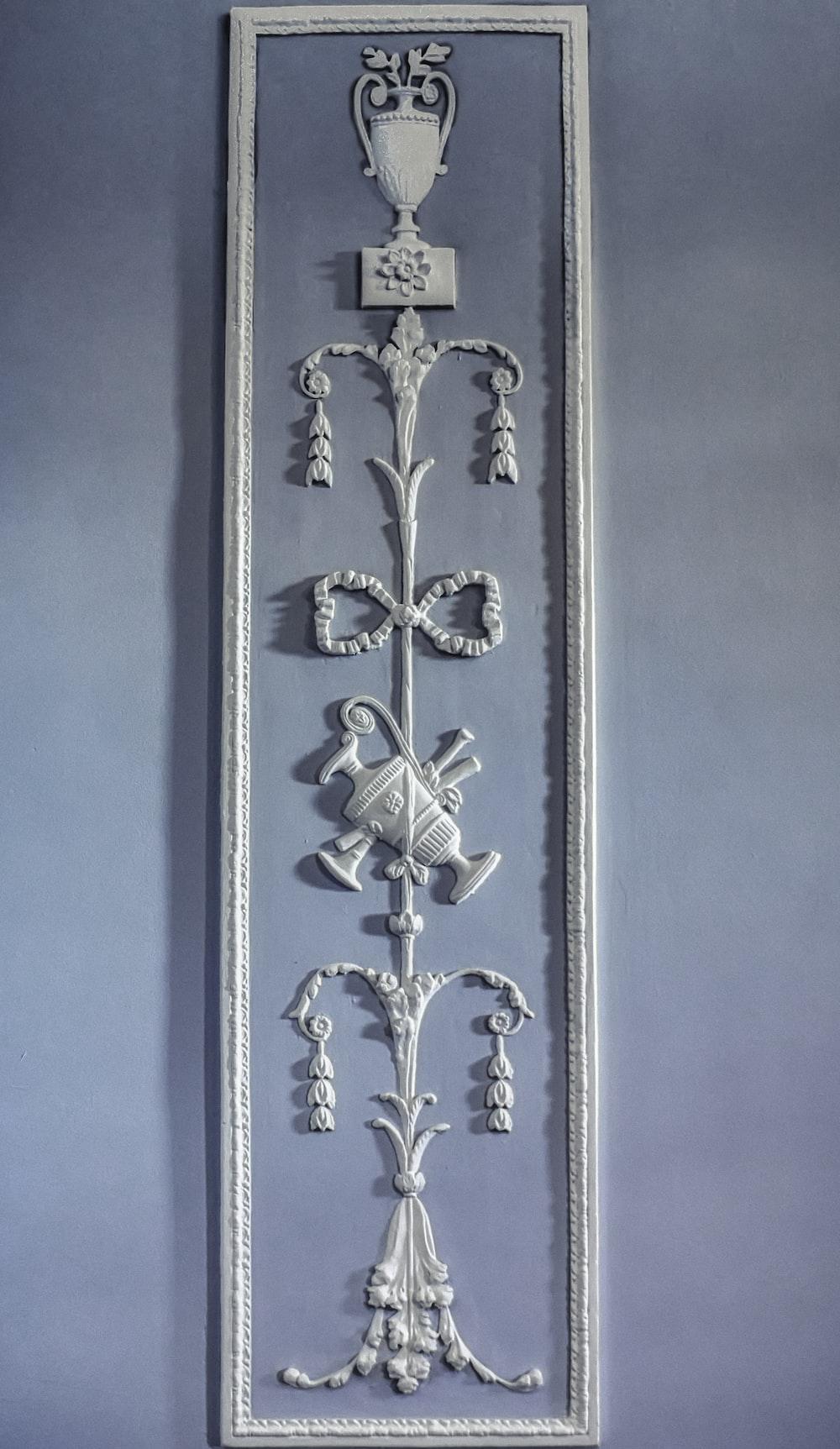 white and gray cross wall decor