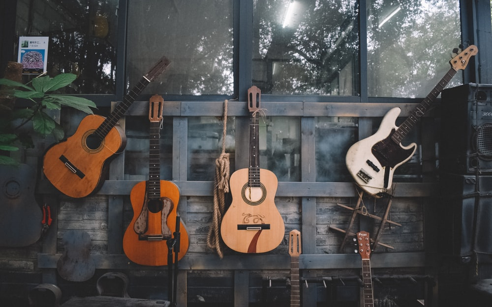 brown and white acoustic guitars