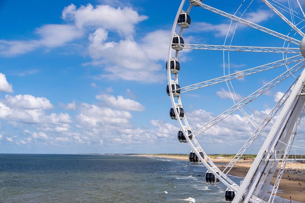 ferris wheel on beach under blue sky during daytime