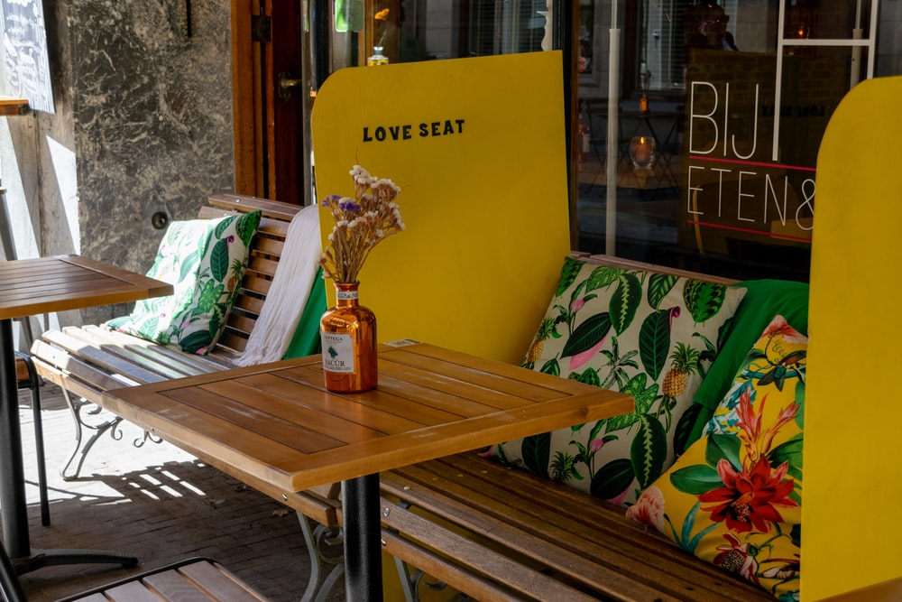 brown wooden table with yellow and white signage