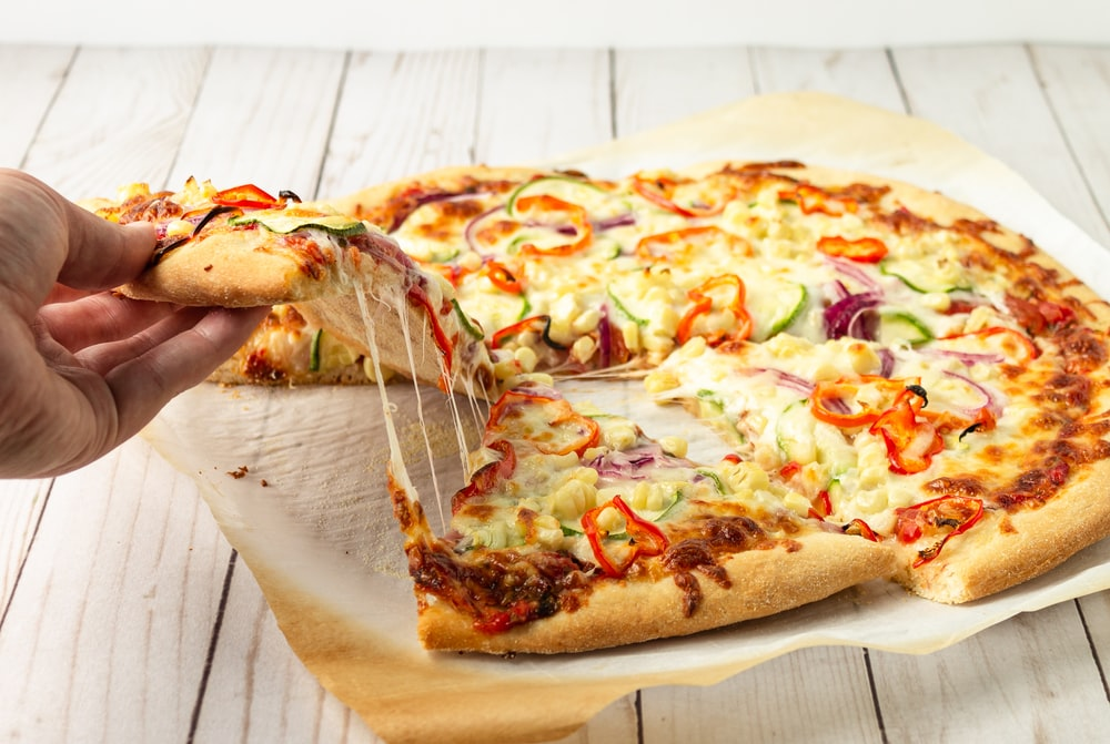 pizza on brown wooden table