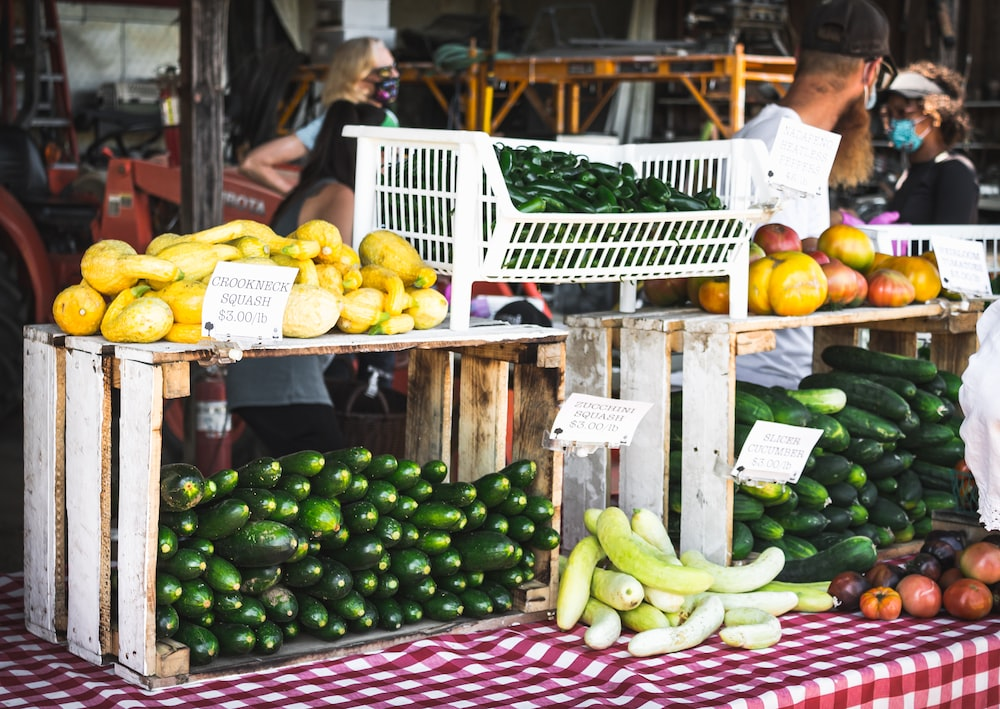green and yellow fruits on white plastic basket