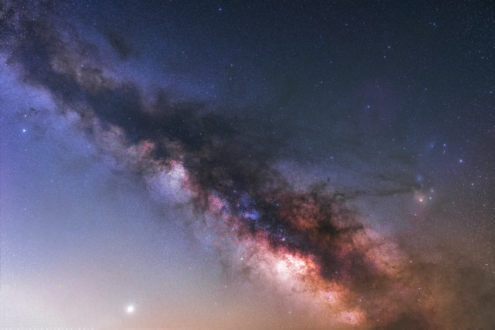 blue and red sky with stars
