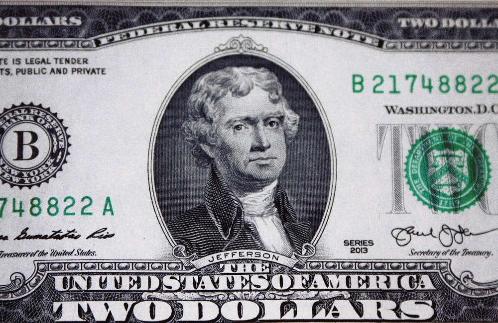 us dollar bill on black and white textile