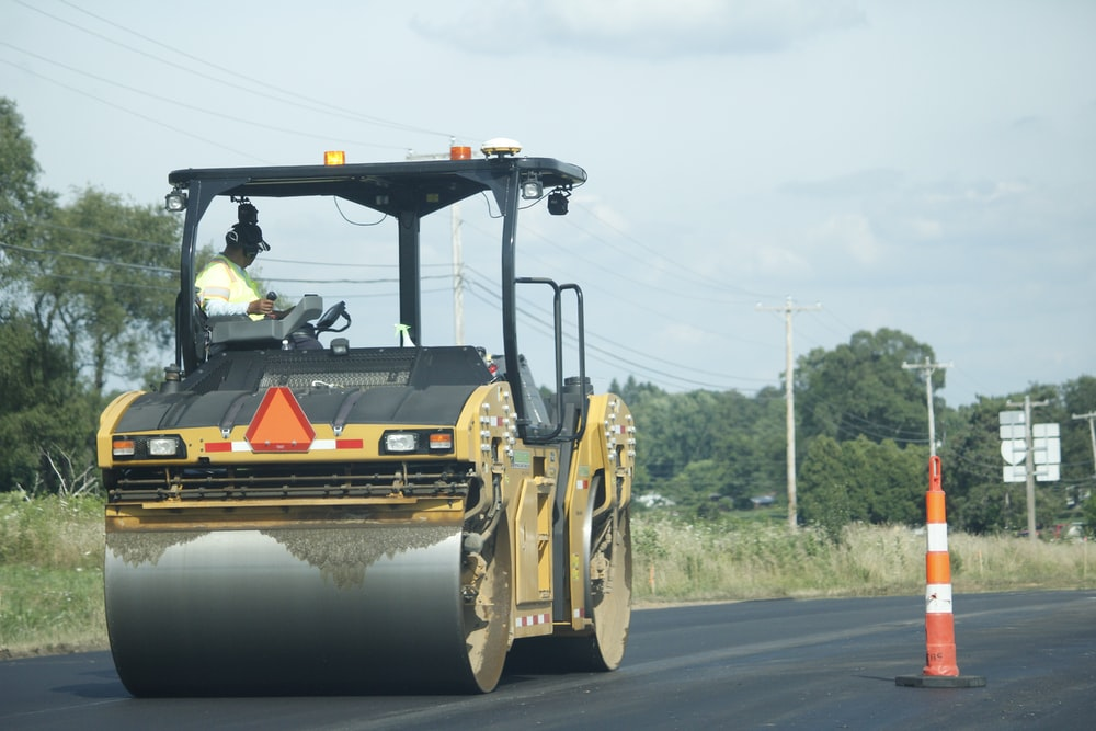 yellow and black heavy equipment on road during daytime