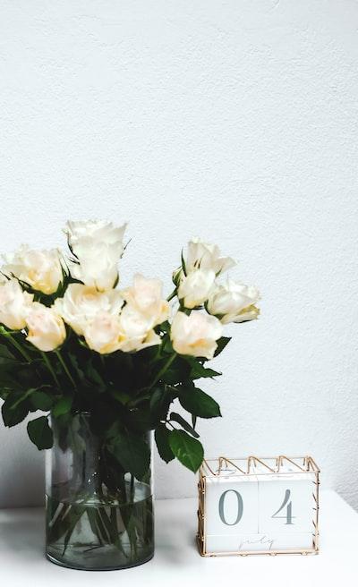white flowers on white ceramic vase