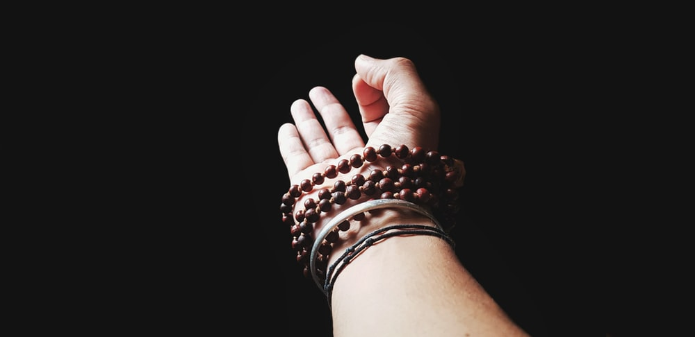 person wearing silver and gold bracelet