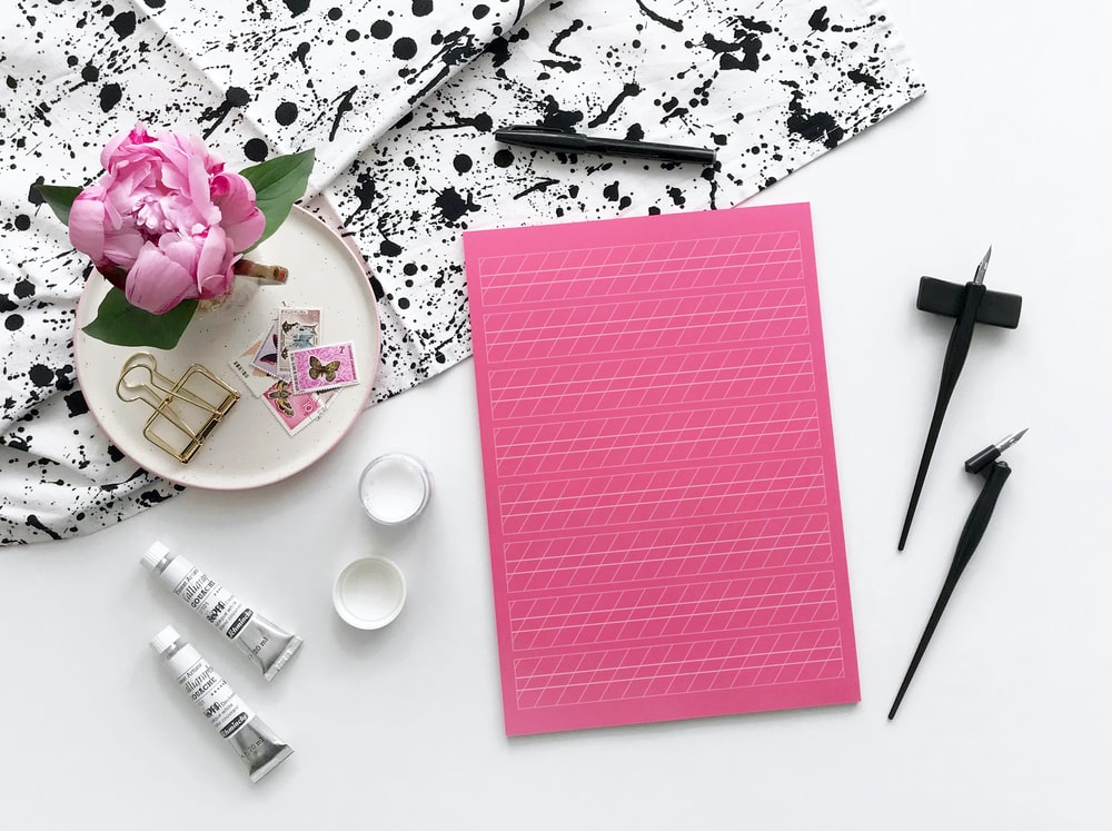 pink paper on white table