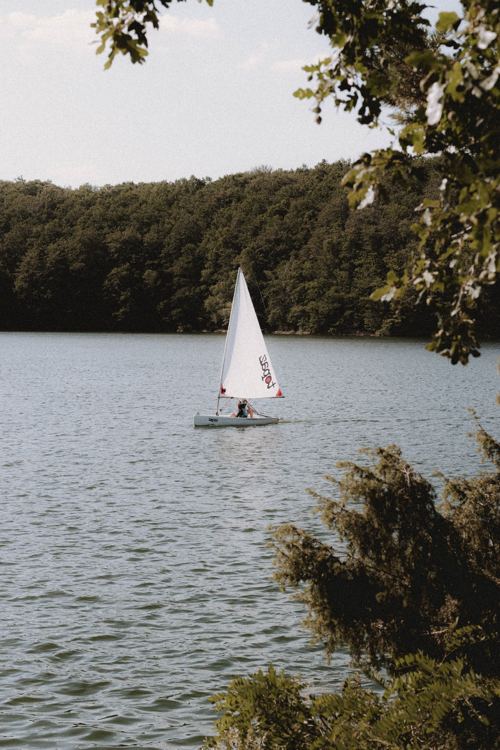 white sailboat on body of water during daytime