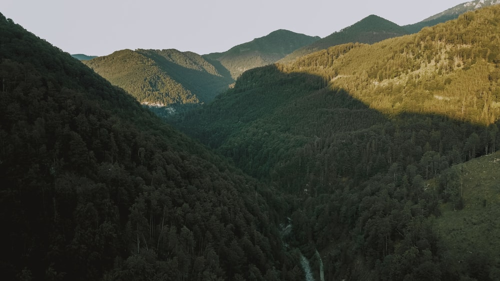 green and brown mountains under white sky during daytime
