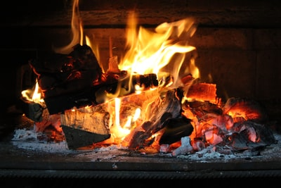 burning firewood on fire pit fireplace teams background