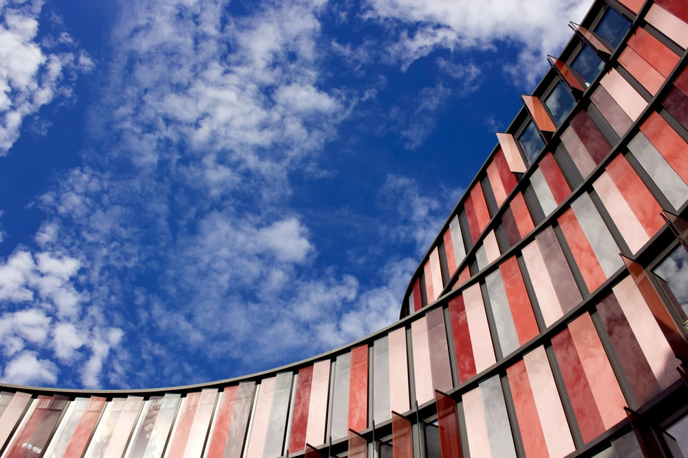 red and white concrete building under blue sky