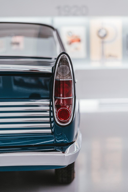 blue and silver car in tilt shift lens