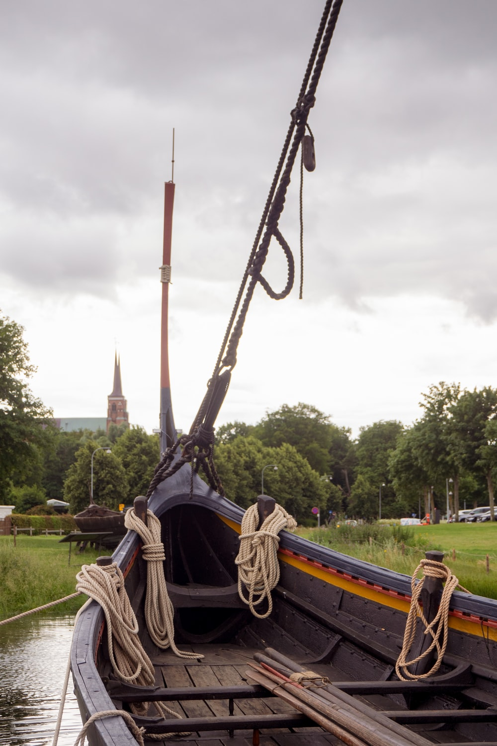 black and brown boat on green grass field during daytime