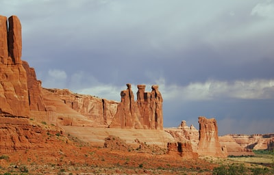 brown rock formation under white clouds during daytime utah zoom background