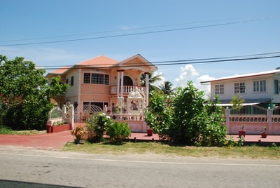 white and brown concrete house guyana teams background