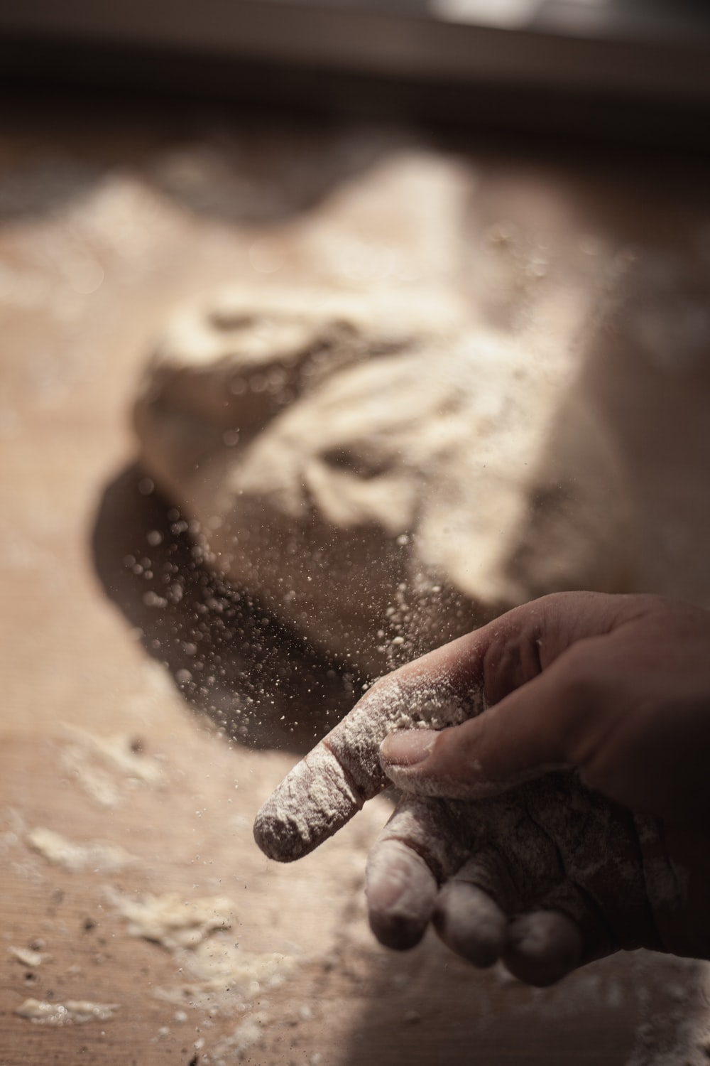 persons hand with white powder