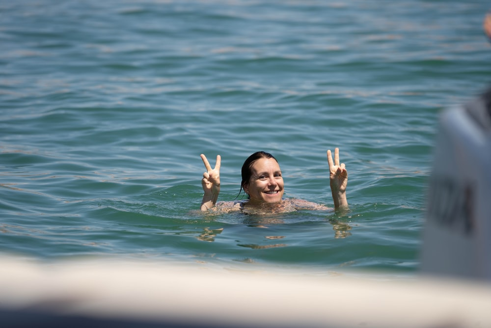 girl in water during daytime