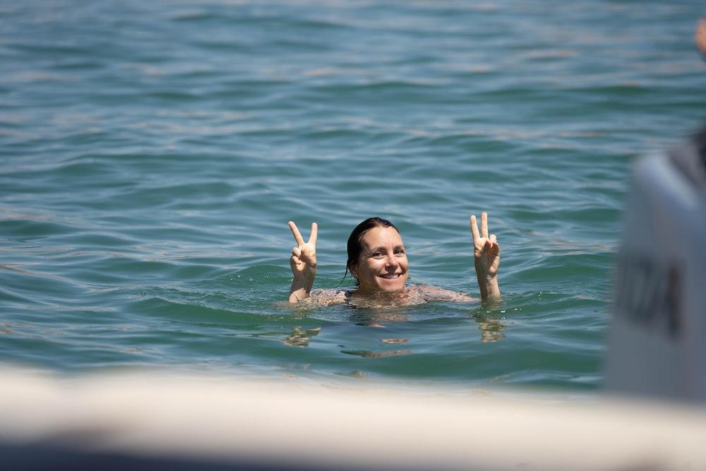 girl in water during daytime