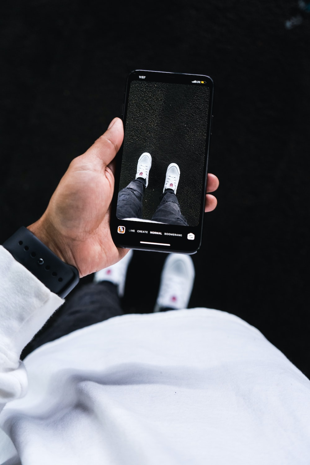 person holding black iphone case