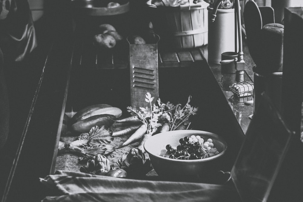 grayscale photo of bowl of food on table