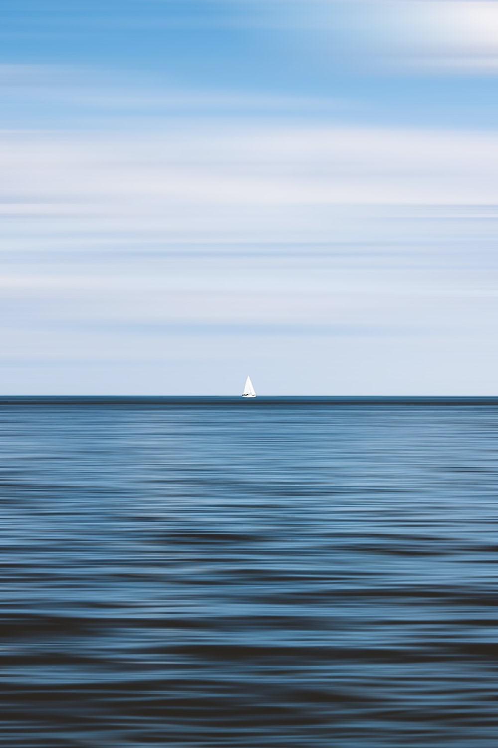 white sailboat on sea during daytime