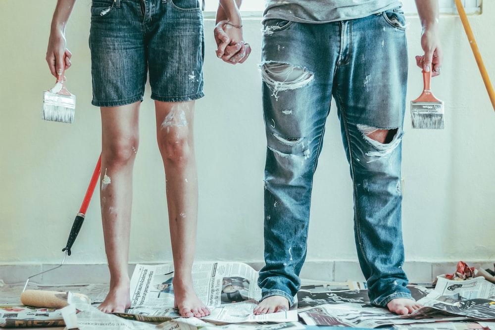 2 person wearing blue denim jeans