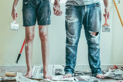 2 person wearing blue denim jeans paint zoom background