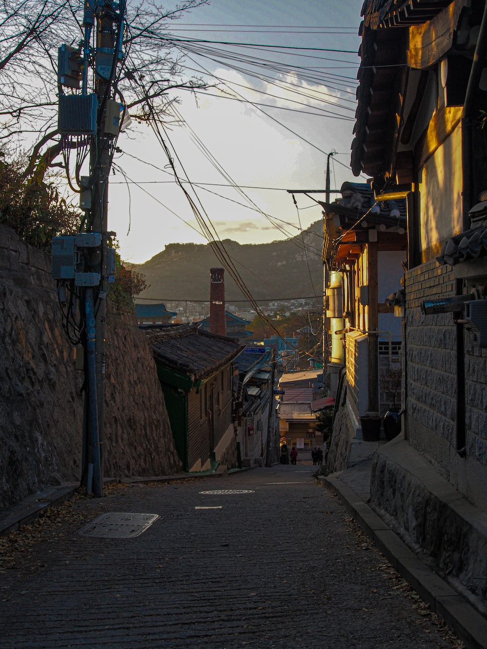brown wooden houses near road during daytime