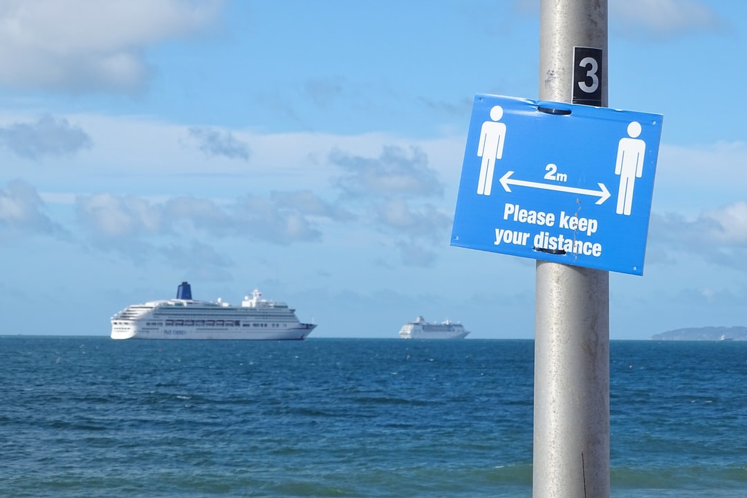 The Covid-19 pandemic.  Cruise Liners going nowhere. Moored in Bournemouth Bay.  A sign telling and reminding people to keep apart. When these beautiful ships will sail again with people on, who knows. When will be able to be properly together, let's hope one day soon.  Until then we keep apart in more ways than one.