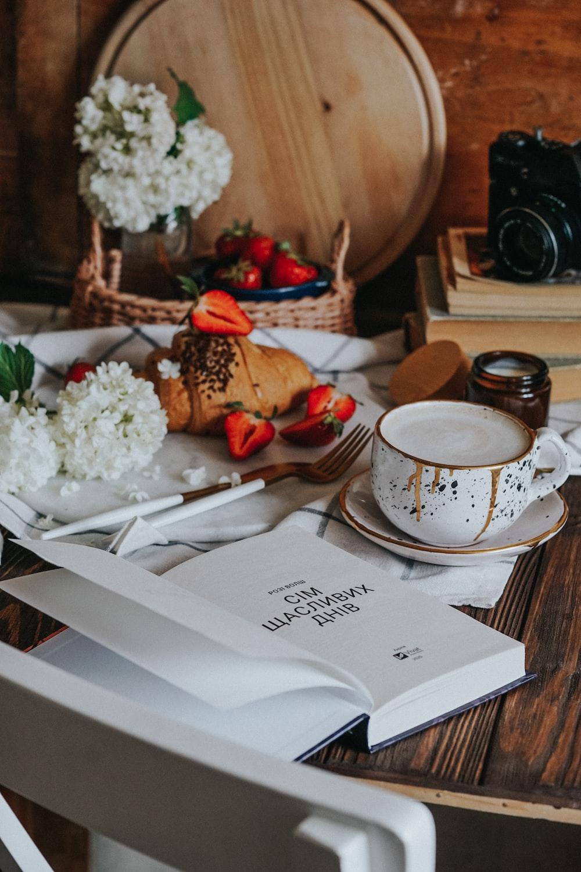 white rice on white ceramic plate beside white ceramic mug