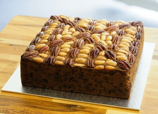 brown bread with brown nuts on brown wooden table