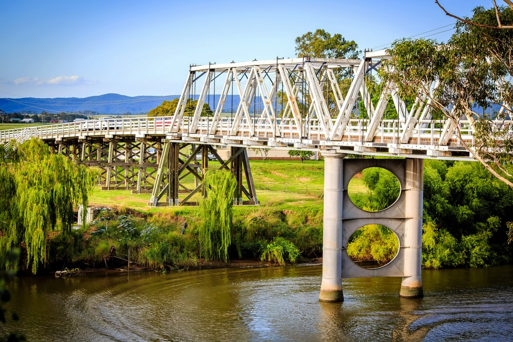 white metal bridge over river during daytime