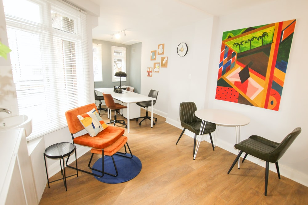 orange and black chair beside white table