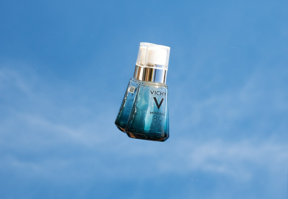 blue and white glass bottle