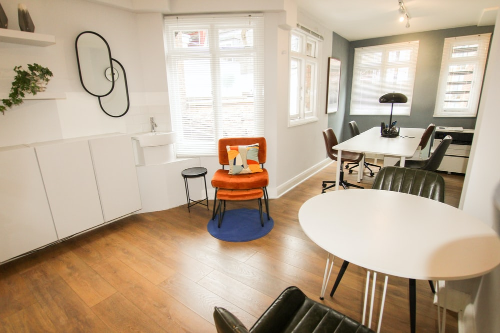 orange and black chair beside white round table