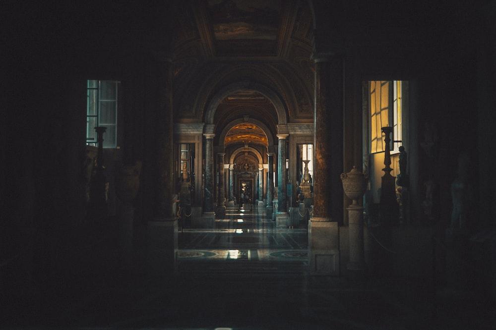 people walking on hallway during night time