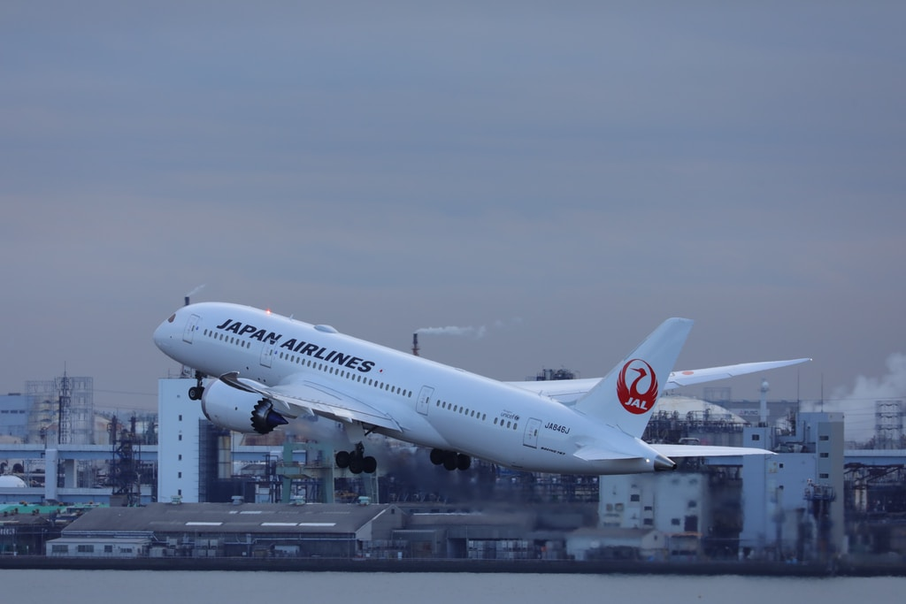 White Japan Airlines plane leaving Tokyo.