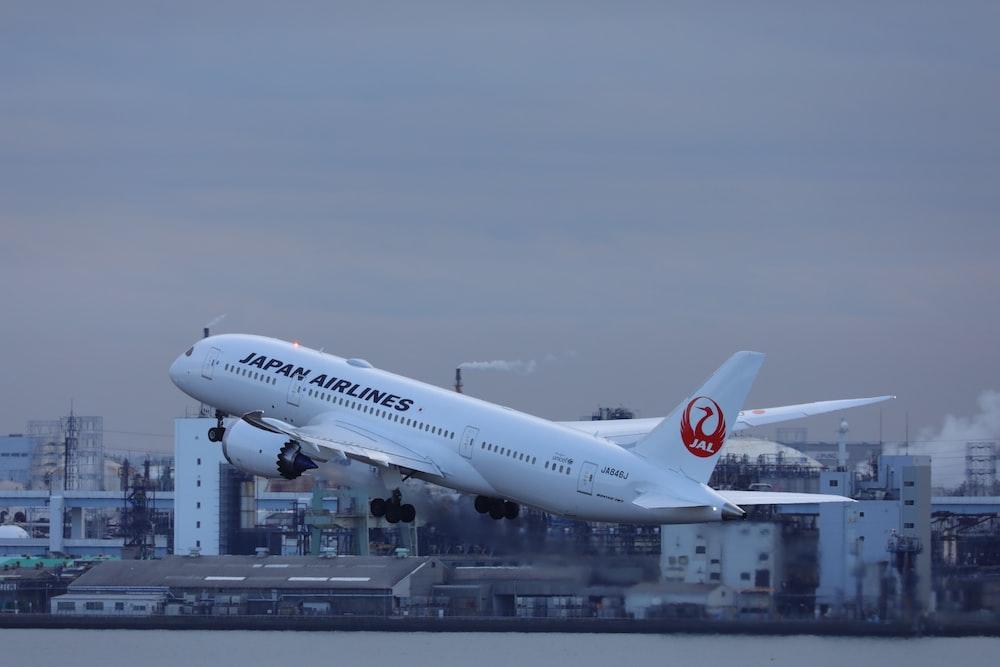white passenger plane on airport during daytime