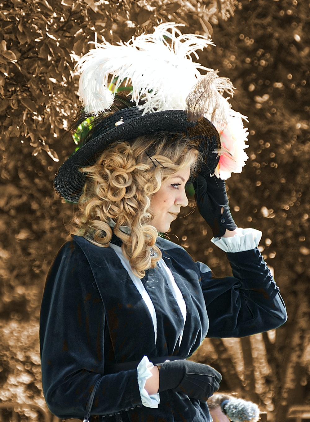 woman in black jacket and white floral headdress
