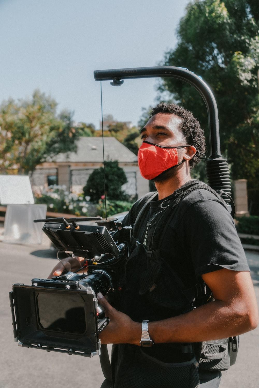 man in black crew neck t-shirt sitting on black motorcycle during daytime