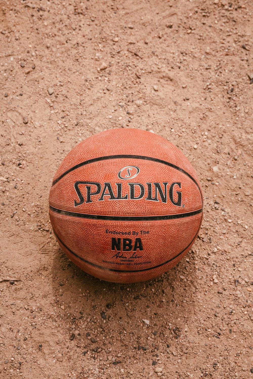 brown basketball on white sand