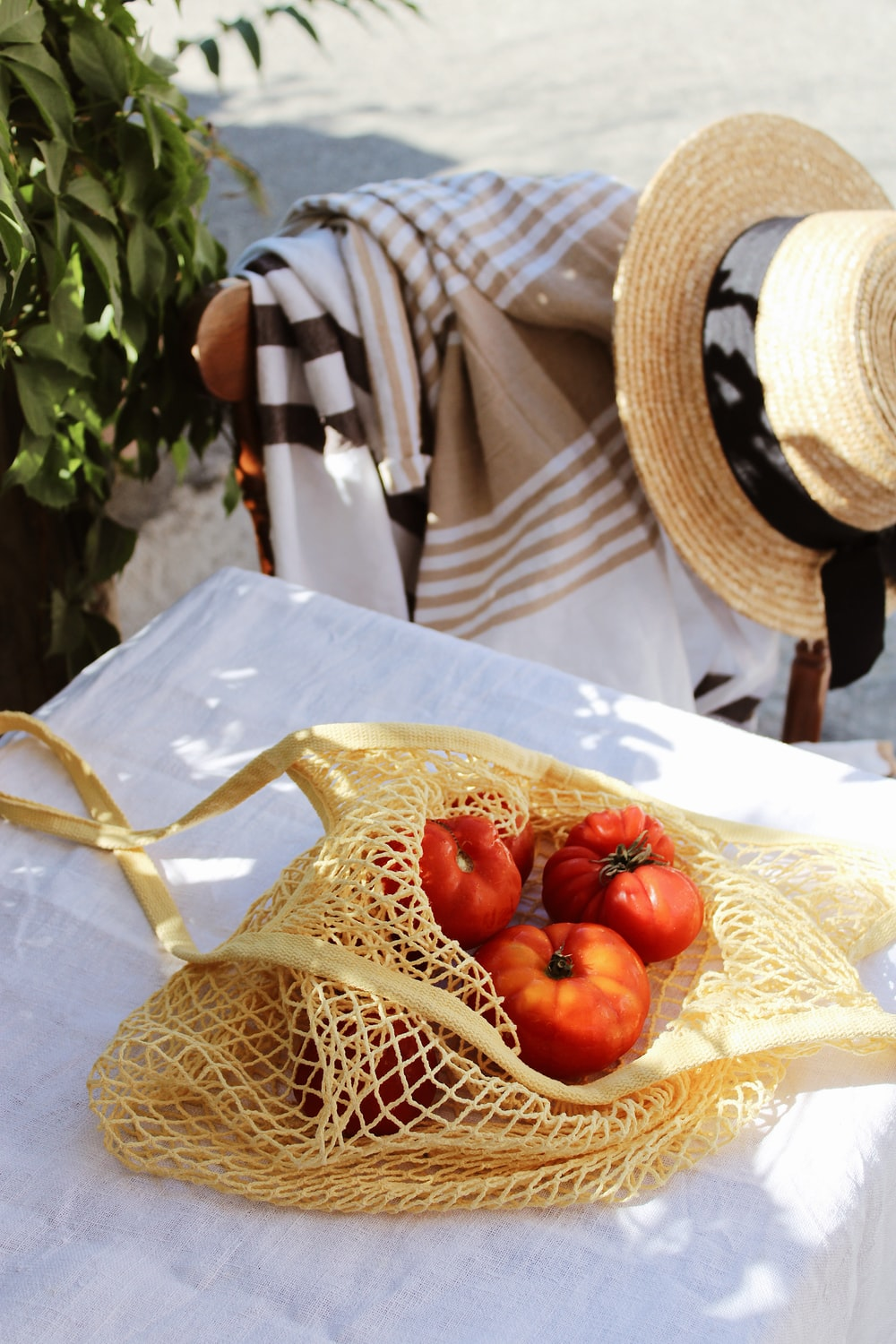 red tomato on brown woven basket