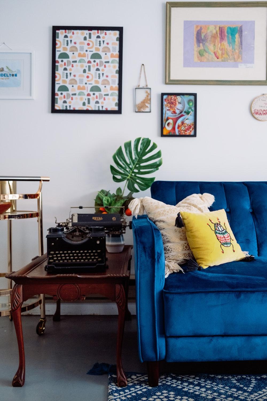 blue sofa with throw pillows